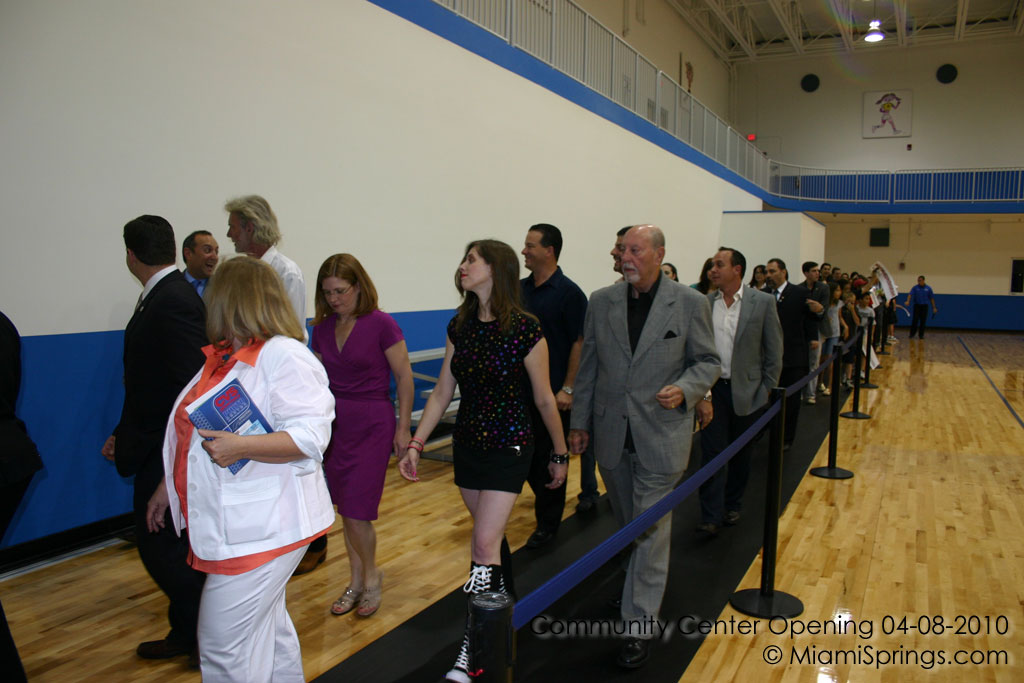 Dignitaries walking in to view the new gym.