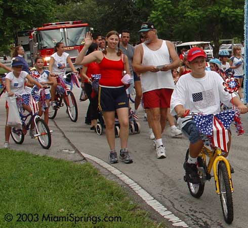 Kids biking in the Miami Springs July 4th Parade