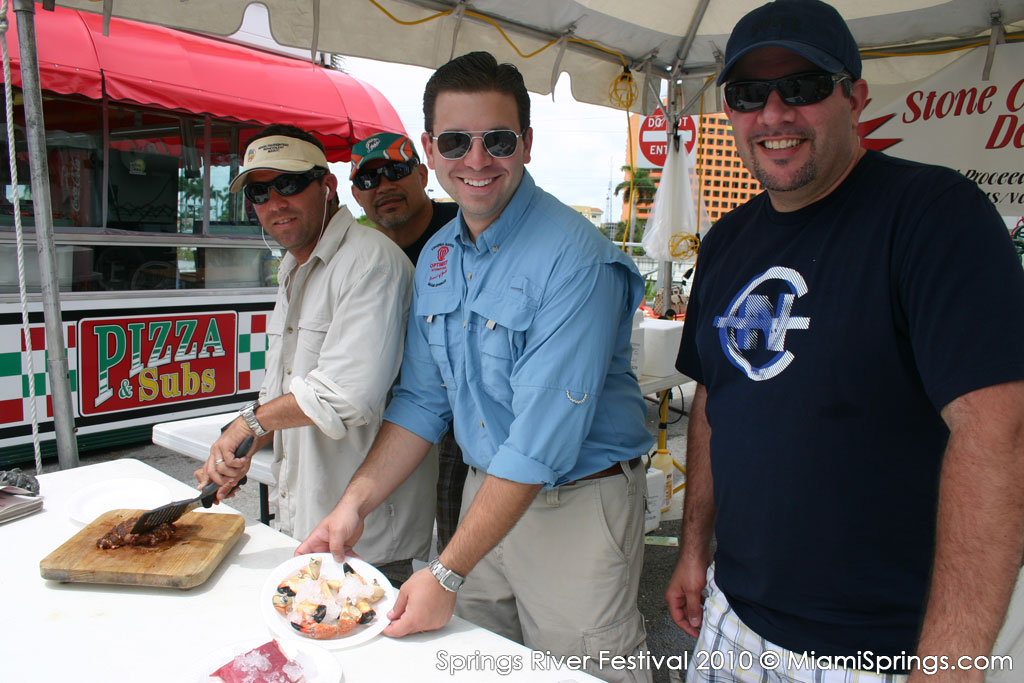 Dan Espino and the Optimist Club volunteers serving up a mean stone crab…yum yum!
